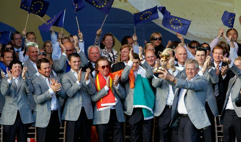 NEWPORT, WALES - OCTOBER 04:  European Team Captain Colin Montgomerie poses with the Ryder Cup alongside his team at the closing cermonies following Europe's 14.5 to 13.5 victory over the USA at the 2010 Ryder Cup at the Celtic Manor Resort on October 4, 2010 in Newport, Wales.  (Photo by Sam Greenwood/Getty Images)