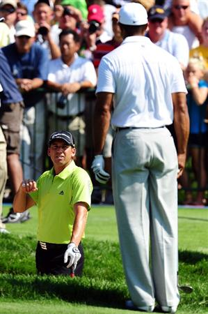 CHASKA, MN - AUGUST 12:  (L-R) Sergio Garcia of Spain and Tiger Woods talk on the practice ground during the third preview day of the 91st PGA Championship at Hazeltine National Golf Club on August 12, 2009 in Chaska, Minnesota.  (Photo by Stuart Franklin/Getty Images)