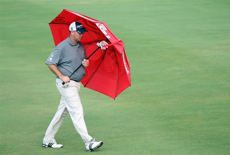 KAPALUA, HI - JANUARY 08:  Boo Weekley walks in the rain during the first round of the Mercedes-Benz Championship at the Plantation Course on January 8, 2009 in Kapalua, Maui, Hawaii.  (Photo by Sam Greenwood/Getty Images)