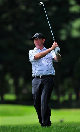 MUNICH, GERMANY - JUNE 26:  David Drysdale of Scotland plays his approach shot on the 18th hole during the second round of The BMW International Open Golf at The Munich North Eichenried Golf Club on June 26, 2009, in Munich, Germany.  (Photo by Stuart Franklin/Getty Images)