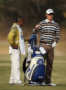 DELHI, INDIA - FEBRUARY 08:  Magnus A Carlsson of Sweden decides on his club for his second shot at the 10th hole during the second round of the Emaar-MGF Indian Masters at the Delhi Golf Club, on February 8, 2008 in Delhi, India.  (Photo by David Cannon/Getty Images)