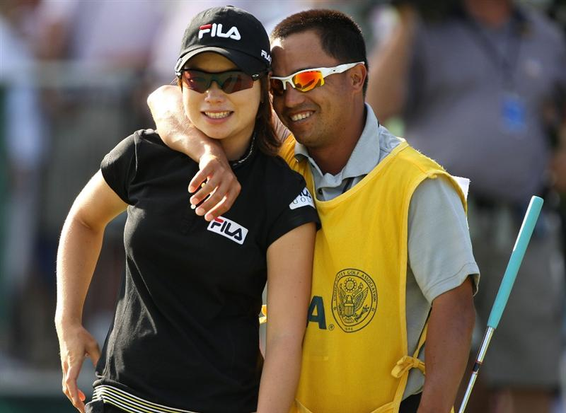 BETHLEHEM, PA - JULY 12:  Caddie Zac Austin (R) hugs Eun Hee Ji (L)of South Korea after making a birdie on the 72nd hole to win the 2009 U.S. Women's Open at Saucon Valley Country Club on July 12, 2009 in Bethlehem, Pennsylvania.  (Photo by Streeter Lecka/Getty Images)