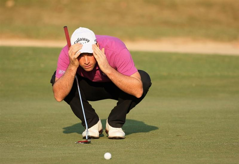 HONG KONG, CHINA - NOVEMBER 20:  Oliver Wilson of England lines up his putt on the 17th hole during the first round of the UBS Hong Kong Open at the Hong Kong Golf Club on November 20, 2008 in Fanling, Hong Kong.  (Photo by Stuart Franklin/Getty Images)