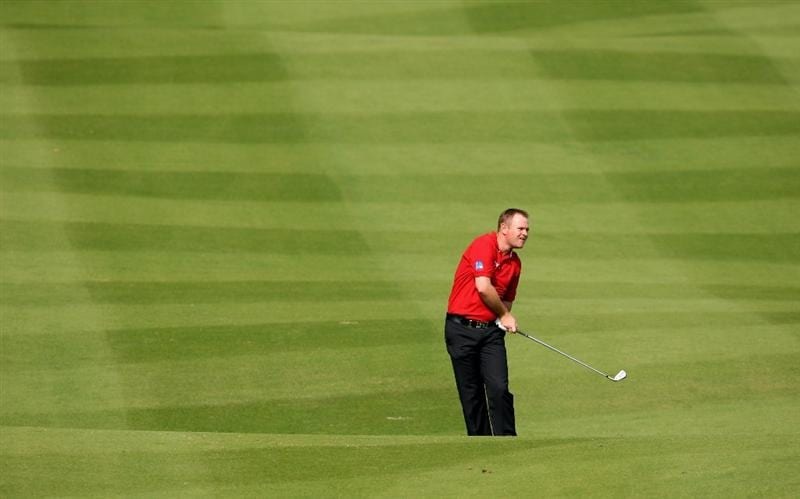 SHENZHEN, CHINA - NOVEMBER 26:  Alastair Forsyth of Scotland plays his approach shot during the pro - am of the Omega Mission Hills World Cup at the Mission Hills Resort on November 26, 2008 in Shenzhen, China.  (Photo by Stuart Franklin/Getty Images)