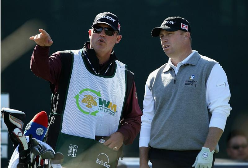 SCOTTSDALE, AZ - FEBRUARY 04:  John Rollins talks with his caddie Heath Holt on the 16th hole during the first round of the Waste Management Phoenix Open at TPC Scottsdale on February 4, 2011 in Scottsdale, Arizona.  (Photo by Christian Petersen/Getty Images)