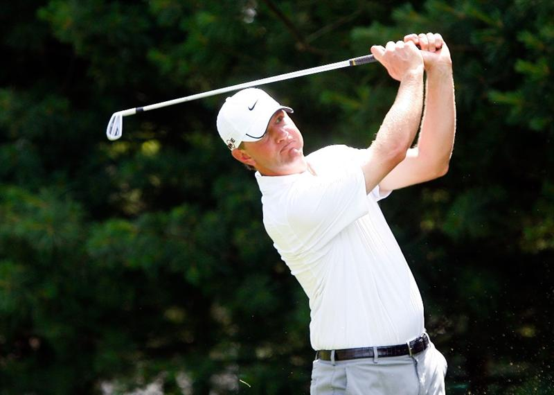 CROMWELL, CT - JUNE 25:  Lucas Glover drives off the eighth hole tee during round one of the 2009 Travelers Championship at TPC River Highlands on June 25, 2009 in Cromwell, Connecticut. (Photo by Jim Rogash/Getty Images)