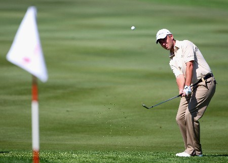 ABU DHABI, UNITED ARAB EMIRATES - JANUARY 20:  Mark Foster of England plays a chip shot on the second hole during the final round of The Abu Dhabi Golf Championship at Abu Dhabi Golf Club on January 20, 2008 in Abu Dhabi.  (Photo by Andrew Redington/Getty Images)