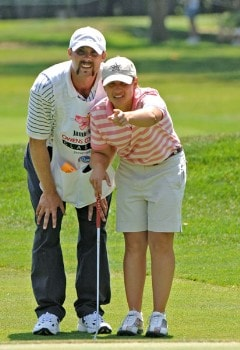 Heather Bowie and her caddy Jeremy Young line up a putt on the 16th hole during the final round of the Jamie Farr Owens Corning Classic July 10, 2005. Bowie won the tournament in a three-hole playoff.Photo by Al Messerschmidt/WireImage.com