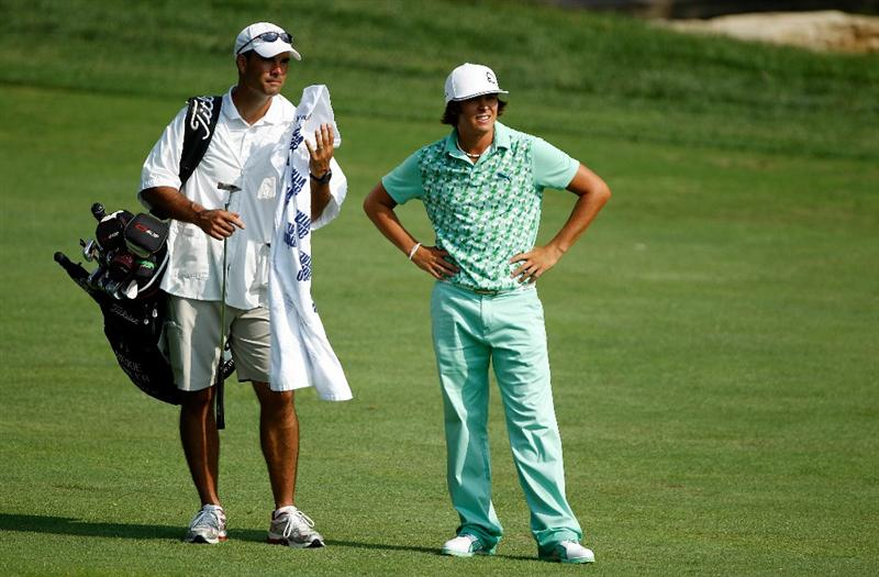DUBLIN, OH - JUNE 04:  Rickie Fowler waits with his caddie Donnie Darr on the 18th hole during the second round of the Memorial Tournament presented by Morgan Stanley at Muirfield Village Golf Club on June 4, 2010 in Dublin, Ohio.  (Photo by Scott Halleran/Getty Images)