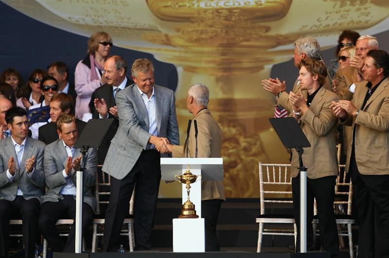 NEWPORT, WALES - OCTOBER 04: Team captains Colin Montgomerie and Corey Pavin shake hands at the Closing Ceremony of the 2010 Ryder Cup at the Celtic Manor Resort on October 4, 2010 in Newport, Wales. (Photo by Richard Heathcote/Getty Images)
