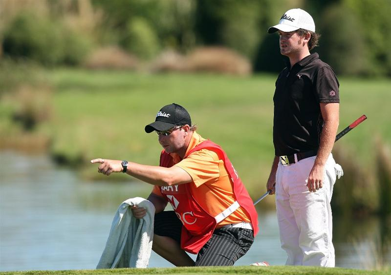 CHRISTCHURCH, NEW ZEALAND - MARCH 08:  Josh Geary of New Zealand lines up a putt with his caddie during day four of the New Zealand PGA Championship at the Clearwater Golf Club on March 8, 2009 in Christchurch, New Zealand.  (Photo by Marty Melville/Getty Images)
