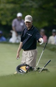 Joe Ogilvie tosses his wedge on his bag after a birdie chip on the 16th hole during the third round of the Cialis Western Open on the No. 4 Dubsdread course at Cog Hill Golf and Country Club in Lemont, Illinois on July 8, 2006.Photo by Michael Cohen/WireImage.com
