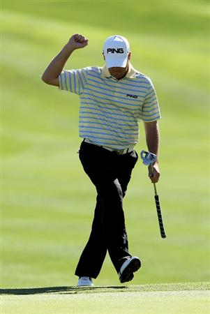 LA QUINTA, CA - JANUARY 25:  Alex Prugh reacts after chipping in for eagle on the 11th hole during the final round of the Bob Hope Classic at the Palmer Private Course at PGA West on January 25, 2010 in La Quinta, California.  (Photo by Jeff Gross/Getty Images)
