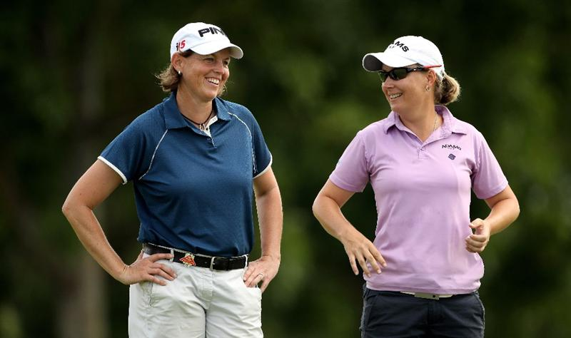 SINGAPORE - FEBRUARY 25:  Wendy Ward of the USA (left) and Lindsey Wright of Australia laugh togther after they both chipped in for birdie on the first hole during the first round of the HSBC Women's Champions at the Tanah Merah Country Club on February 25, 2010 in Singapore.  (Photo by Andrew Redington/Getty Images)