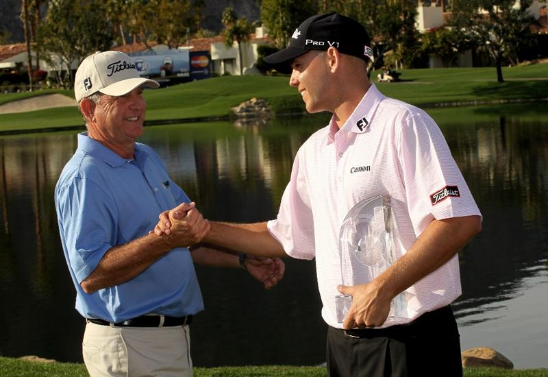 LA QUINTA, CA - JANUARY 25:  Bill Haas (R) is congratulated by father and former tournament champion Jay Haas on the 18th green after Bill's victory at the Palmer Private course at PGA West during the final round of the Bob Hope Classic on January 25, 2010 in La Quinta, California. (Photo by Stephen Dunn/Getty Images)