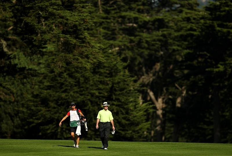SAN FRANCISCO - NOVEMBER 04:  Tom Kite walks down the 13th fairway with his caddie Sandy Jones during round 1 of the Charles Schwab Cup Championship at Harding Park Golf Course on November 4, 2010 in San Francisco, California.  (Photo by Ezra Shaw/Getty Images)
