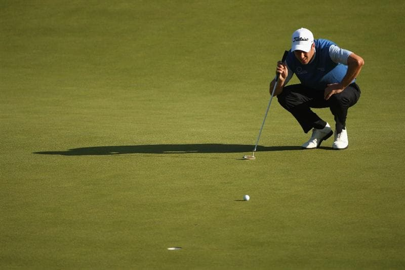 LUSS, SCOTLAND - JULY 09:  Ross Fisher of England lines up a putt on the 11th green during the First Round of The Barclays Scottish Open at Loch Lomond Golf Club on July 09, 2009 in Luss, Scotland.  (Photo by Andrew Redington/Getty Images)