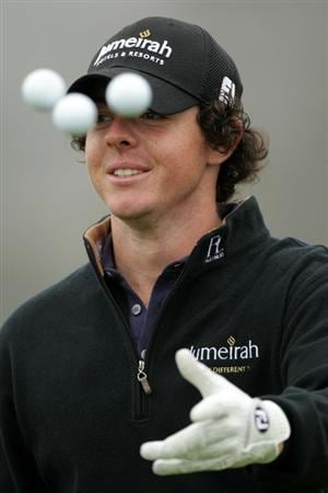 PEBBLE BEACH, CA - JUNE 14:  Rory McIlroy of Northern Ireland tosses three golf balls off a green during a practice round prior to the start of the 110th U.S. Open at Pebble Beach Golf Links on June 14, 2010 in Pebble Beach, California.  (Photo by Andrew Redington/Getty Images)