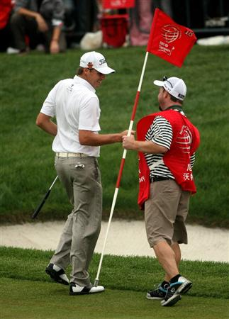 SHANGHAI, CHINA - NOVEMBER 07:  Nick Watney of the USA celebrates with his caddie after his eagle on the 18th hole during the third round of the WGC-HSBC Champions at Sheshan International Golf Club on November 7, 2009 in Shanghai, China.  (Photo by Andrew Redington/Getty Images)