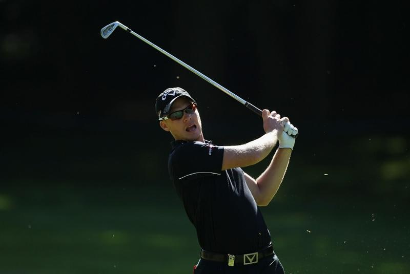 VIRGINIA WATER, ENGLAND - MAY 25:    Danny Willett of England hits an approach shot during the Pro-Am round prior to the BMW PGA Championship at Wentworth Club on May 25, 2011 in Virginia Water, England.  (Photo by Warren Little/Getty Images)