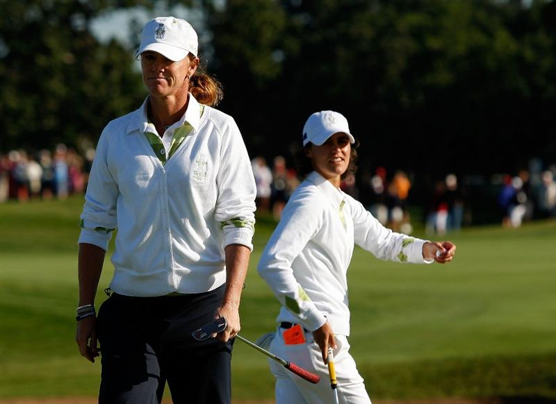 SUGAR GROVE, IL - AUGUST 22: (L-R)  Helen Alfredsson and Tania Elosegui of the European Team walk across the second green during the saturday morning fourball matches at the 2009 Solheim Cup at Rich Harvest Farms on August 22, 2009 in Sugar Grove, Illinois.  (Photo by Chris Graythen/Getty Images)