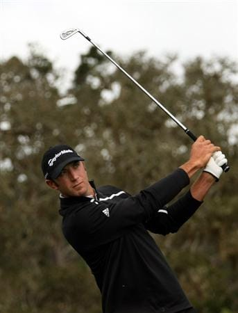 PEBBLE BEACH, CA - FEBRUARY 12: Dustin Johnson hits his tee shot on the 17th hole during the first round of the the AT&T Pebble Beach National Pro-Am on Pebble Beach Golf Links on February 12, 2009 in Pebble Beach, California. (Photo by Stephen Dunn/Getty Images)