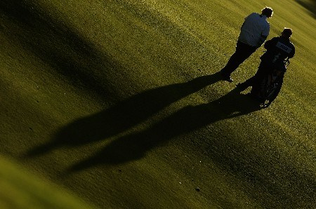 HALMSTAD, SWEDEN - SEPTEMBER 14:  Laura Davies of England waits with her caddie in the 14th fairway during the afternoon fourball matches of the Solheim Cup at on September 14, 2007 in Halmstad, Sweden.  (Photo by Scott Halleran/Getty Images)
