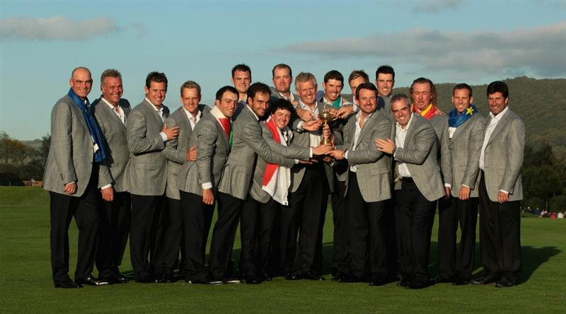 NEWPORT, WALES - OCTOBER 04:  European Team Captain Colin Montgomerie poses with the Ryder Cup  his team and vice captains following Europe's 14.5 to 13.5 victory over the USA at the 2010 Ryder Cup at the Celtic Manor Resort on October 4, 2010 in Newport, Wales.  (Photo by David Cannon/Getty Images)