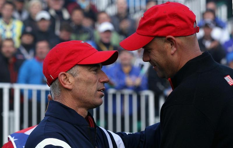 NEWPORT, WALES - OCTOBER 04:  USA Team Captain Corey Pavin (L) greets Stewart Cink on the first tee in the singles matches during the 2010 Ryder Cup at the Celtic Manor Resort on October 4, 2010 in Newport, Wales.  (Photo by David Cannon/Getty Images)