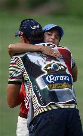 MORELIA, MEXICO- APRIL 25: Lorena Ochoa of Mexico hugs caddie David Brooker after her putt on the 18th hole during the thrid round of the Corona Championship at the Tres Marias Residential Golf Club on April 25, 2009 in Morelia, Michoacan, Mexico. (Photo by Donald Miralle/Getty Images)