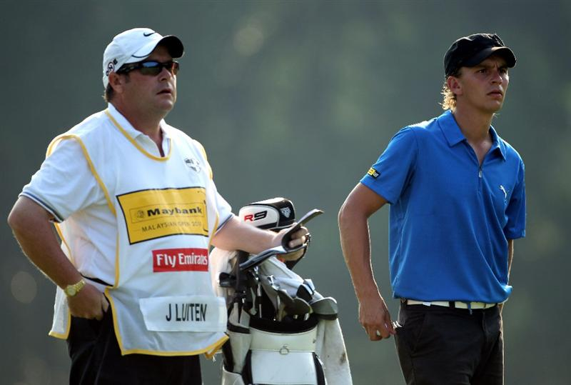 KUALA LUMPUR, MALAYSIA - MARCH 05:  Joost Luiten of The Netherlands waits with his caddie Martin Gray on the first hole during the the second round of the Maybank Malaysian Open at the Kuala Lumpur Golf and Country Club on March 5, 2010 in Kuala Lumpur, Malaysia.  (Photo by Andrew Redington/Getty Images)