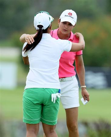 SINGAPORE - FEBRUARY 25:  Lorena Ochoa of Mexico and Ai Miyazato of Japan share a hug on the 18th hole following their round during the first round of the HSBC Women's Champions at Tanah Merah Country Club on February 25, 2010 in Singapore, Singapore.  (Photo by Andy Lyons/Getty Images)