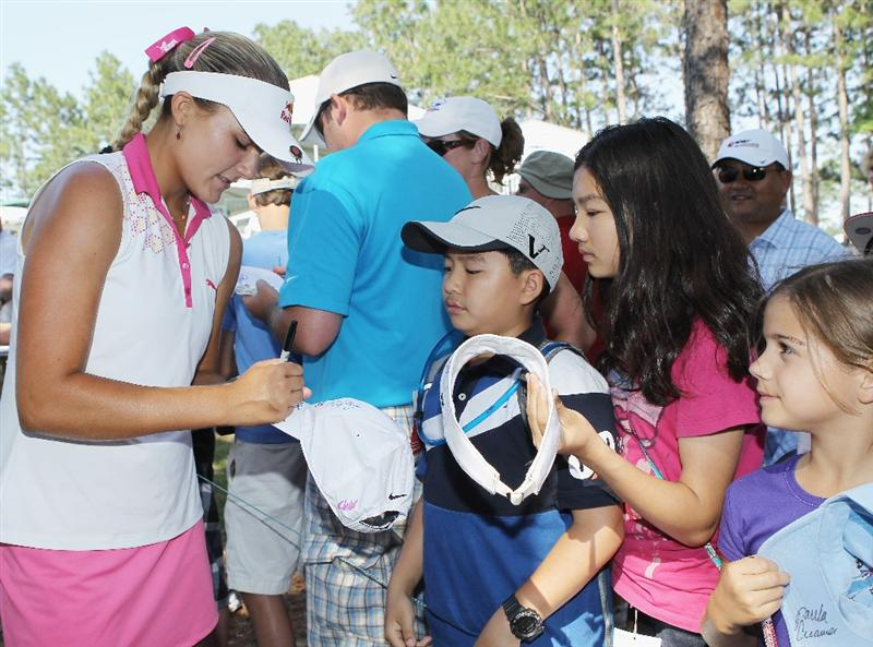 MOBILE, AL - APRIL 30:  Alexis Thompson signs autographs for fans during the third round of the Avnet LPGA Classic at the Crossings Course at the Robert Trent Jones Trail at Magnolia Grove on April 30, 2011 in Mobile, Alabama.  (Photo by Scott Halleran/Getty Images)