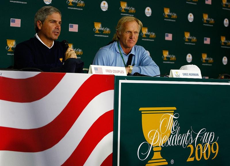 SAN FRANCISCO - OCTOBER 06:  U.S. Team captain Fred Couples, (L) and International Team captain Greg Norman speak with the media during a practice round prior to the start of The Presidents Cup at Harding Park Golf Course on October 6, 2009 in San Francisco, California.  (Photo by Scott Halleran/Getty Images)