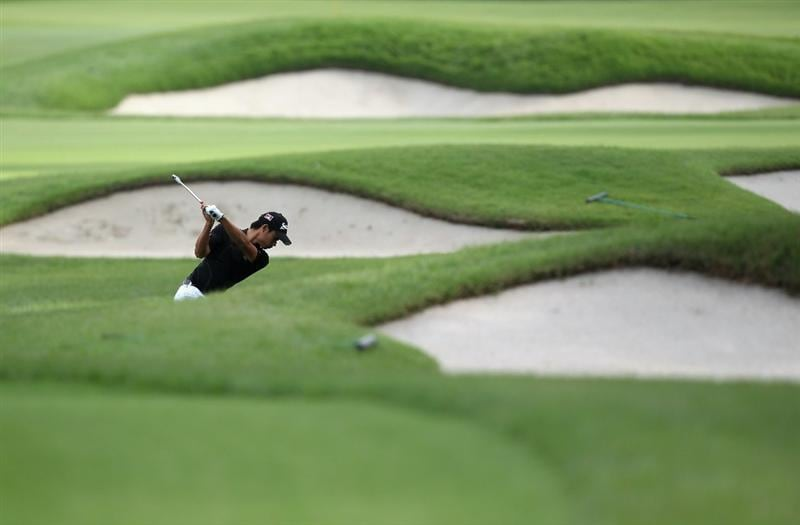 KAWAGOE CITY, JAPAN - OCTOBER 08:  Abel Tam Yuan of Malaysia hits a shot on the 17th hole during the second round of the 2010 Asian Amateur Championship at Kasumigaseki Country Club on October 8, 2010 in Kawagoe City, Japan.  (Photo by Streeter Lecka/Getty Images)