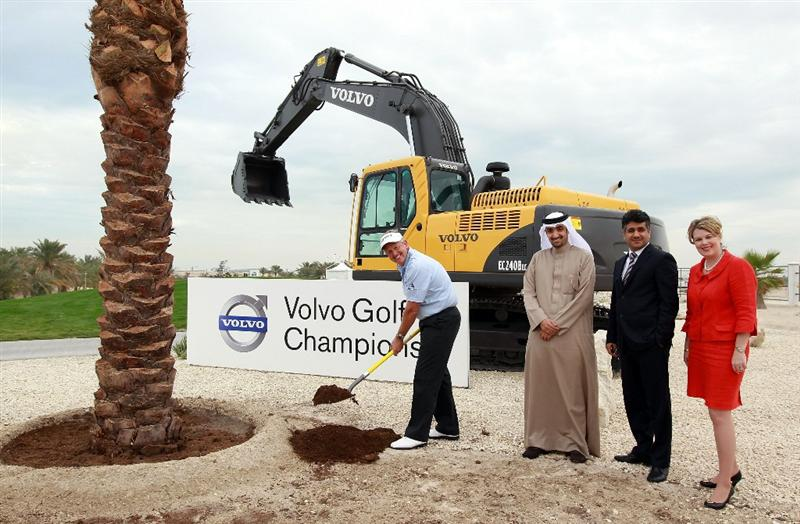 BAHRAIN, BAHRAIN - JANUARY 25: Colin Montgomerie of Scotland, helps plant a commemorative tree beside the 1st tee watched by Shaikh Abdulla Bin Salman Al Khalifa The President of the Bahrain Golf Association, Kamal Ahmed The Chief Operating Officer of The Bahrain Economic Development Board and Susan Stevenson The General Manager of The Royal Golf Club Bahrain as a preview for the 2011 Volvo Champions held at the Royal Golf Club on January 25, 2011 in Bahrain, Bahrain.  (Photo by David Cannon/Getty Images)