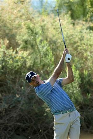 LA QUINTA, CA - JANUARY 21:  Matt Kuchar hits his tee shot on the 17th hole during round three of the Bob Hope Classic at the Nicklaus Private Course at PGA West on January 21, 2011 in La Quinta, California.  (Photo by Stephen Dunn/Getty Images)