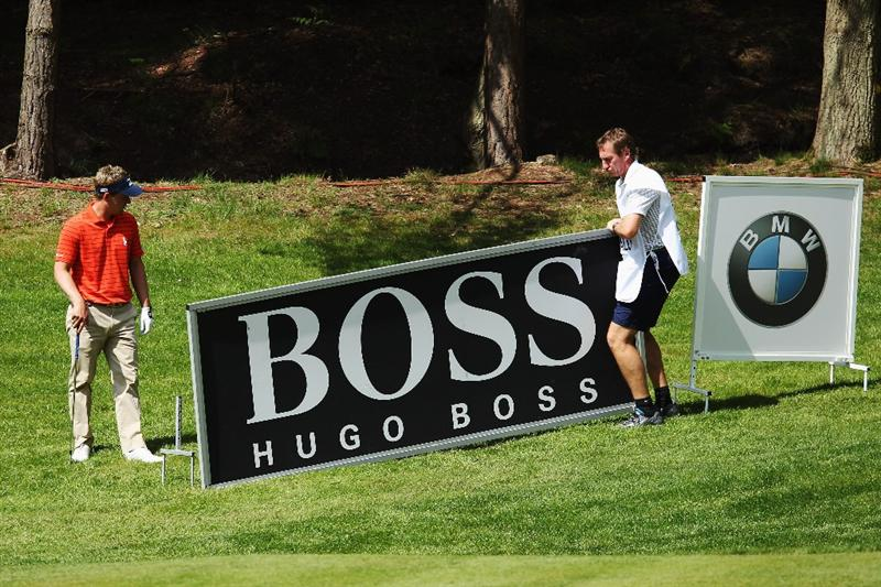 VIRGINIA WATER, ENGLAND - MAY 19:  Luke Donald of England asks for an advertising boad to be moved during the Pro-Am round prior to the BMW PGA Championship on the West Course at Wentworth on May 19, 2010 in Virginia Water, England.  (Photo by Warren Little/Getty Images)