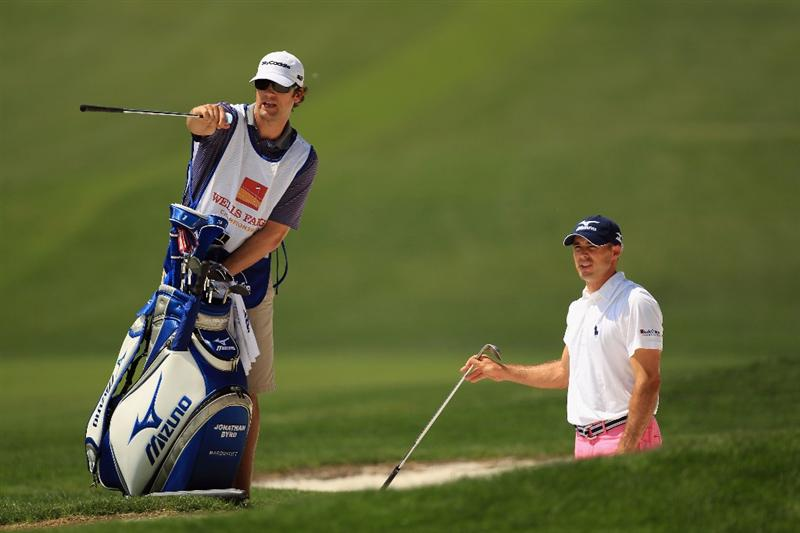 CHARLOTTE, NC - MAY 08:  Jonathan Byrd talks to his caddie Adam Hayes on the 7th hole during the final round of the Wells Fargo Championship at Quail Hollow Club on May 8, 2011 in Charlotte, North Carolina.  (Photo by Streeter Lecka/Getty Images)
