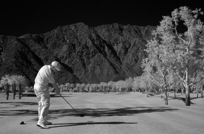 LA QUINTA, CA - JANUARY 23: (EDITORS NOTE: An infared camera was used to create this image) Brian Davis of England hits a tee shot on the fourth hole during the final round of the Bob Hope Classic at the Palmer Private course at PGA West on January 23, 2011 in La Quinta, California.  (Photo by Jeff Gross/Getty Images)