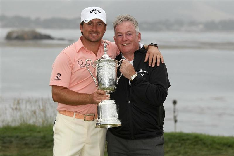 PEBBLE BEACH, CA - JUNE 20:  Graeme McDowell (L) of Northern Ireland celebrates with the trophy alongside his father Ken on the 18th green after winning the 110th U.S. Open at Pebble Beach Golf Links on June 20, 2010 in Pebble Beach, California.  (Photo by Ross Kinnaird/Getty Images)