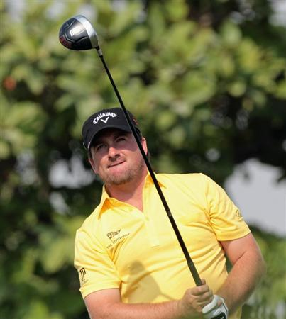 DUBAI, UNITED ARAB EMIRATES - NOVEMBER 23:  Graeme McDowell of Northern Ireland in action during the Pro Am prior to the start of the Dubai World Championship on the Earth Course, Jumeirah Golf Estates on November 23, 2010 in Dubai, United Arab Emirates.  (Photo by David Cannon/Getty Images)