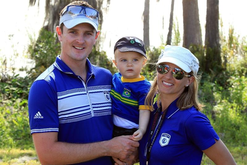 ORLANDO, FL - MARCH 23:  Justin Rose of England and the Lake Nona Team with his wife Kate and son Leo at the 18th hole after the matches had finished with a win for Lake Nona during the second day's play in the 2010 Tavistock Cup, at the Isleworth Golf and Country Club on March 23, 2010 in Orlando, Florida.  (Photo by David Cannon/Getty Images)