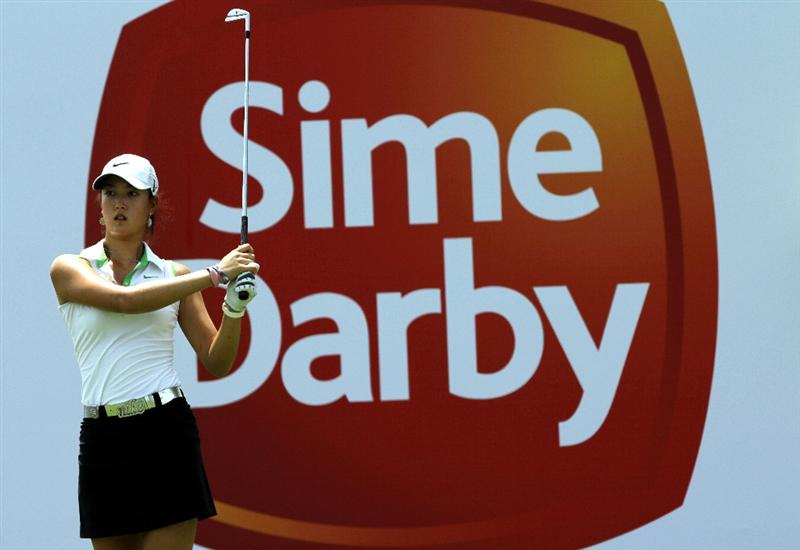 KUALA LUMPUR, MALAYSIA - OCTOBER 22: Michelle Wie of the USA tees off on the 10th hole during Round One of the Sime Darby LPGA on October 22, 2010 at the Kuala Lumpur Golf and Country Club in Kuala Lumpur, Malaysia. (Photo by Stanley Chou/Getty Images)