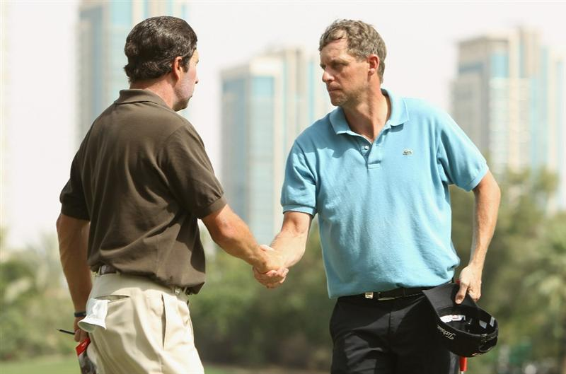 DUBAI, UNITED ARAB EMIRATES - FEBRUARY 11:  Anders Hansen of Denmark shakes hands during the second round for the 2011 Omega Dubai desert Classic held on the Majilis Course at the Emirates Golf Club on February 11, 2011 in Dubai, United Arab Emirates.  (Photo by Ian Walton/Getty Images)