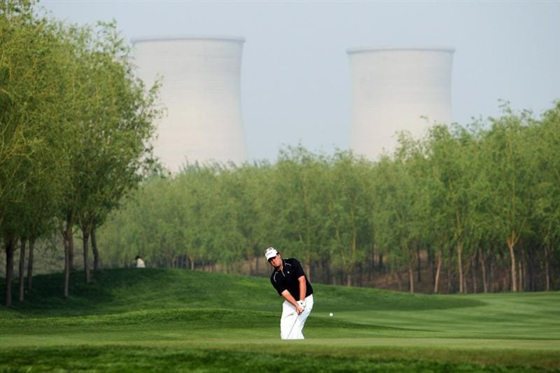 BEIJING - APRIL 17: Chris Gaunt of Australia chips during the round two of the Volvo China Open at the Beijing CBD International Golf Club on April 17, 2009 in Beijing, China.  (Photo by Guang Niu/Getty Images)