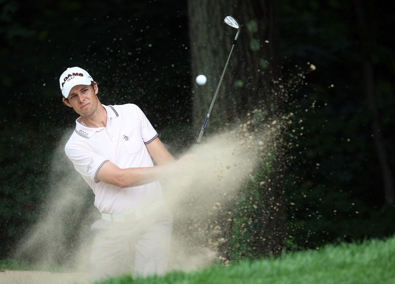 CROMWELL, CT - JUNE 26: Aaron Baddeley of Australia  works out of the rough during round two of the 2009 Travelers Championship at TPC River Highlands on June 26, 2009 in Cromwell, Connecticut. (Photo by Jim Rogash/Getty Images)