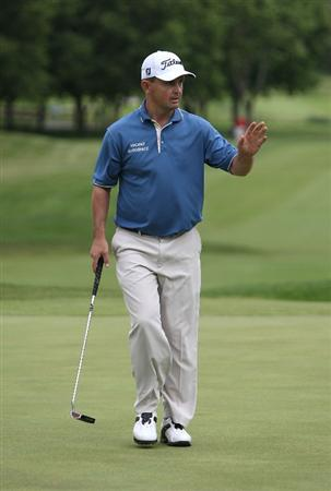 MILWAUKEE - JULY 16: Greg Chalmers of Australia  waves to the crowd after dropping his putt on the 18th hole during the first round of the U.S. Bank Championship on July 16, 2009 at the Brown Deer Park golf course in Milwaukee, Wisconsin. (Photo by Jonathan Daniel/Getty Images)