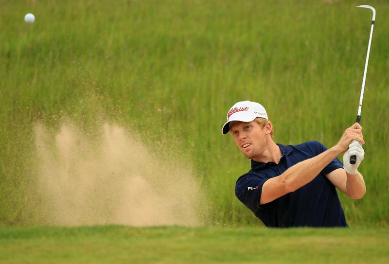 NEWPORT, WALES - JUNE 05:  Andrew Dodt of Australia plays out of the 16th greenside bunker during the third round of the Celtic Manor Wales Open on The Twenty Ten Course on June 5, 2010 in Newport, Wales.  (Photo by Warren Little/Getty Images)