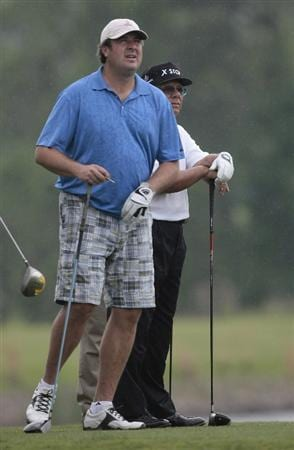 BIRMINGHAM, AL - MAY 14: Singer Vince Gill (L) watches a drive from the fifth tee with Lee Trevino during the Thursday Pro-AM of the Regions Charity Classic at the Robert Trent Jones Golf Trail at Ross Bridge on May 14, 2009  in Birmingham, Alabama. (Photo by Dave Martin/Getty Images)